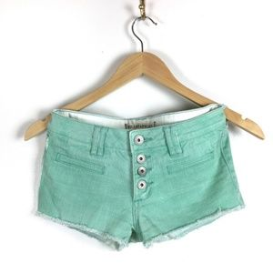 Bullhead Black | mint green cutoff jean shorts | 1